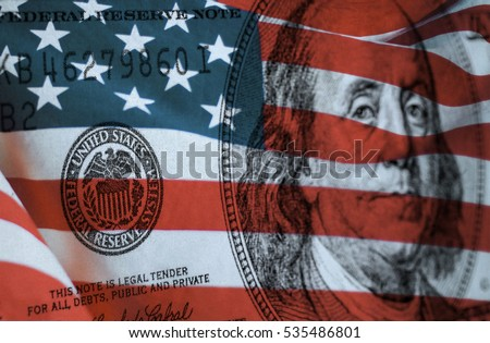 Federal reserve system symbol on hundred dollar bill with united states of america flag Royalty-Free Stock Photo #535486801