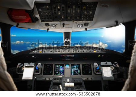 The interior of cockpit modern business jet, against a beautiful sky, background  Royalty-Free Stock Photo #535502878