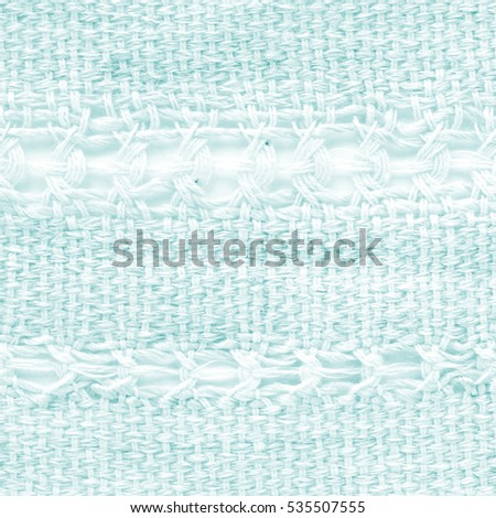 Turquoise hand weaving matting tweed fabric texture. Closeup square fragment  #535507555