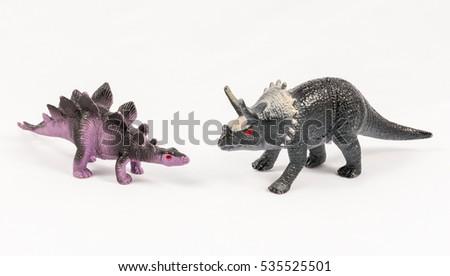 Stegosaurus and triceratops dinosaur toy models, isolated on white background #535525501