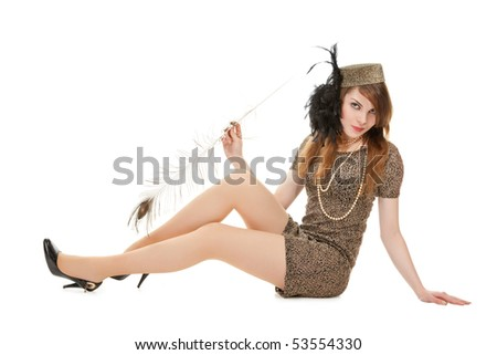 Studio portrait of attractive young woman #53554330