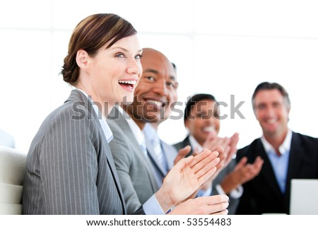 Portrait of smiling businessteam applauding a presentation against a white background #53554483