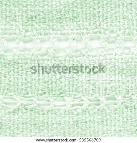 Green hand weaving matting tweed fabric texture. Closeup square fragment  #535566709