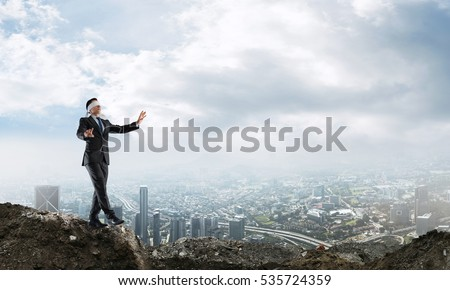 Concept of risk and danger in business with man steping blind Royalty-Free Stock Photo #535724359