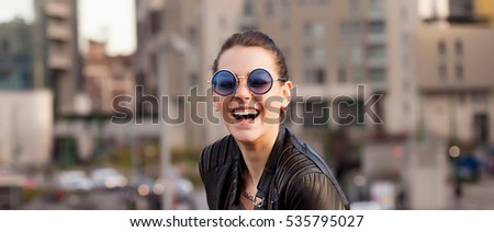 Girl with sunglasses laughing in the city letterbox #535795027
