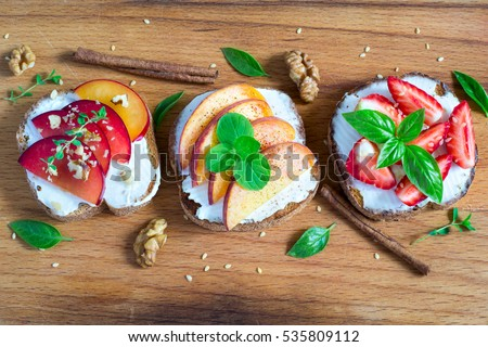 Fruit Bruschetta with spices and nuts. Top view.  #535809112