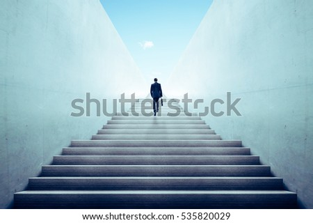 Businessman climbing stairs ,Ambitions concept . Royalty-Free Stock Photo #535820029