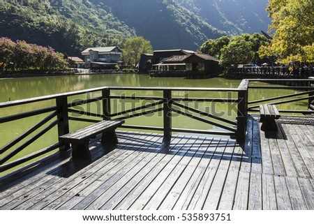 wooden benches at a lake #535893751