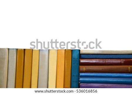 Old books on a white background. Stack with books in multicolored covers. Is the library bookstore. Reading paper books. Knowledge in textbooks. Perorally sheets of ancient books. #536016856