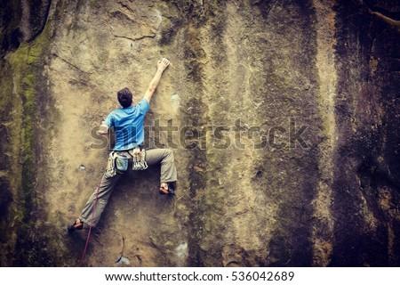 Rock climber. Royalty-Free Stock Photo #536042689
