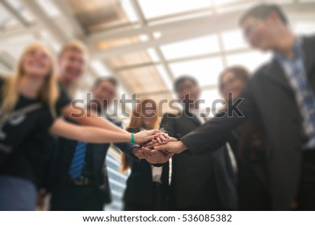 Group of Business People Join the Hand or United as Business  Group Teamwork Concept #536085382