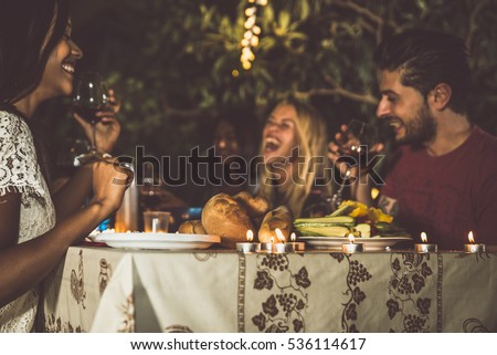 Group of friends making barbecue in the backyard at dinner time #536114617