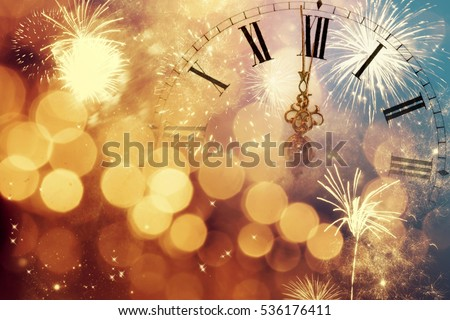 New Year's at midnight - Old clock with stars snowflakes and holiday lights #536176411