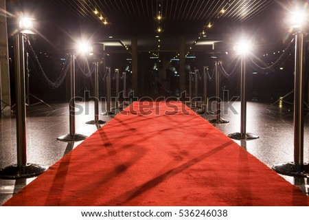 Long red carpet between rope barriers on entrance. Royalty-Free Stock Photo #536246038