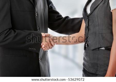 Young business couple handshaking #53629072