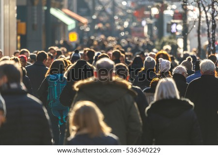 Crowd of people walking on a street in New York City  #536340229