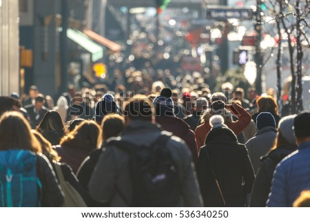 Crowd of people walking on a street in New York City  #536340250