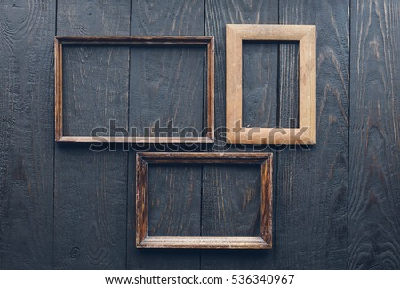 vintage frames on old wooden wall #536340967