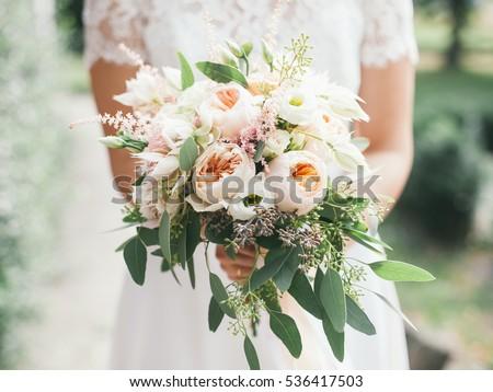 wedding bouquet in bride's hands, david austin  Royalty-Free Stock Photo #536417503
