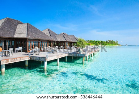 Beautiful beach with water bungalows at Maldives #536446444