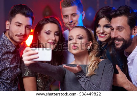 Woman taking a selfie with all crew