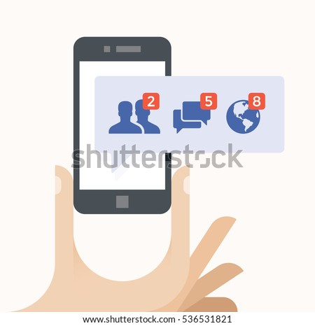 Human hand holding mobile phone with social network notification on screen. Concepts: Social media services like Facebook addiction etc.