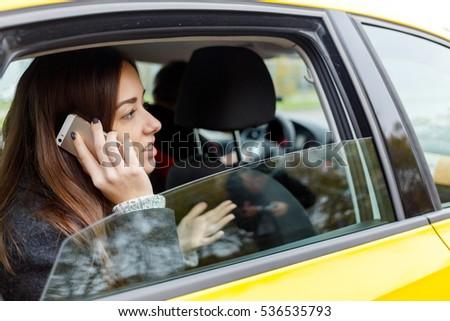 Beautiful girl talking on phone #536535793