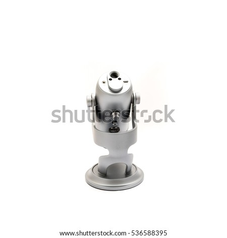 Close up bottom of microphone isolated on white background. Modern space grey USB microphone with usb, audio connection and arm/boom stand mount for podcast, broadcasting or voice over works.