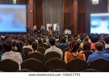 Abstract blurred photo of conference hall or seminar room with attendee background Royalty-Free Stock Photo #536617741