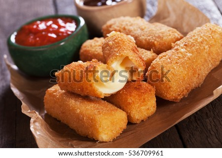 Breaded mozzarella cheese sticks with ketchup and bbq sauce Royalty-Free Stock Photo #536709961