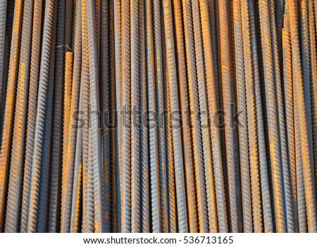 Steel bars background. Iron bars rustic background. Reinforcing bar background. #536713165