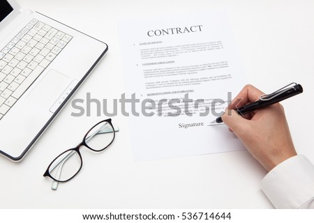man hand sign on contract document with fountain pen, glasses and notebook on white backgrounds