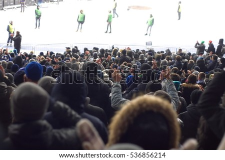 fans in the stadium supporting the team in the winter #536856214