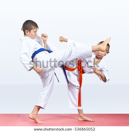 Two friends athletes are beating kicks #536865052