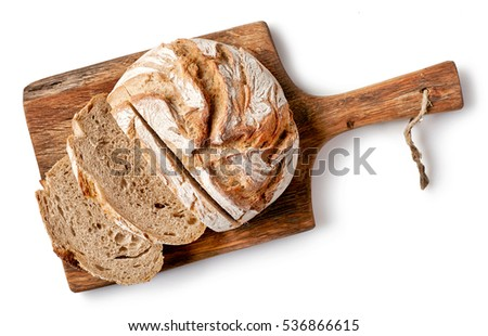 freshly baked bread on wooden cutting board isolated on white background, top view #536866615