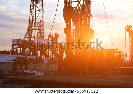 field oil workers at work #536917522