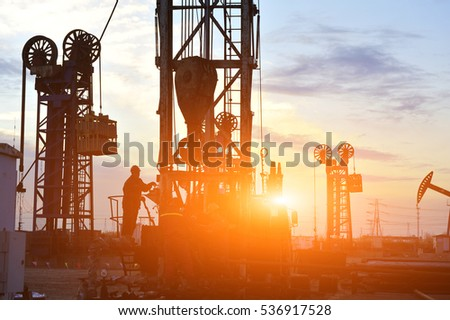 field oil workers at work #536917528