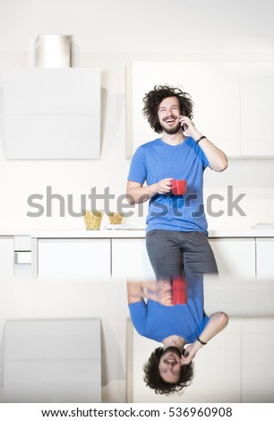 kitchen, men and smart phone. Man in kitchen using cell phone and drinking coffe #536960908