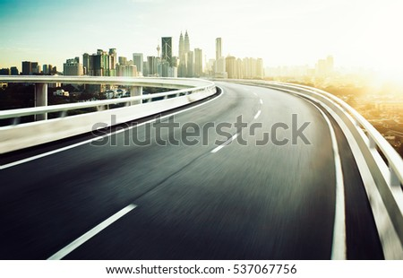 Highway overpass motion blur with city background . #537067756