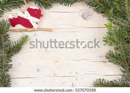 Branch of fir with little winter bird. Christmas background with copy space #537070588
