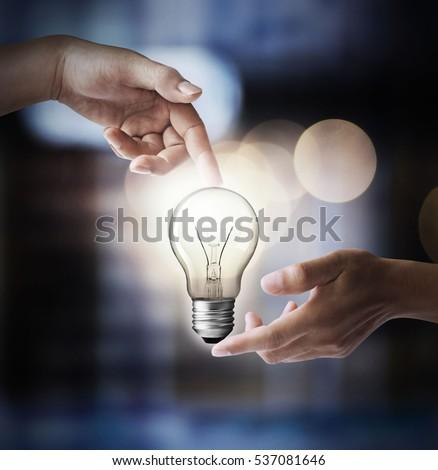 Finger lamp, energy-saving concept. #537081646