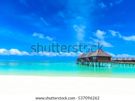 beach with water bungalows at Maldives #537096262
