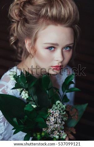 Top view of gorgeous fairytale bride in vin elegant white robe, with flowers bouquet, face closeup #537099121