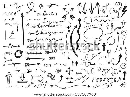 Hand drawn vector arrows set.