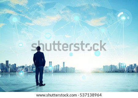 International business concept with businessman on city skyline background with network on map and sunlight #537138964