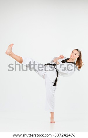 The karate girl with black belt #537242476