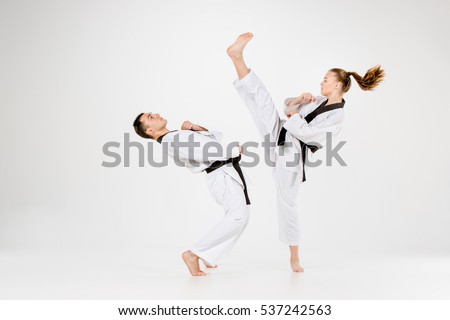 The karate girl and boy with black belts #537242563