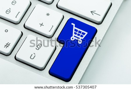 Computer notebook keyboard with icon shopping cart on key. E-commerce concept #537305407