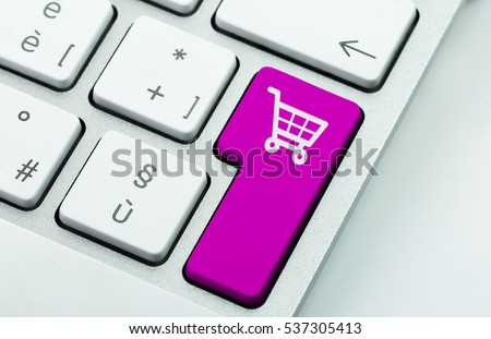 Computer notebook keyboard with icon shopping cart on key. E-commerce concept #537305413