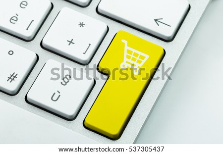 Computer notebook keyboard with icon shopping cart on key. E-commerce concept #537305437